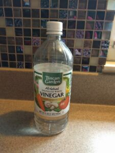 Plain white vinegar (notice I have Aldi brand!)
