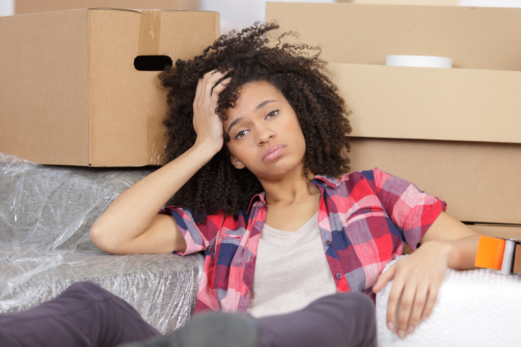Tired woman surrounded by boxes