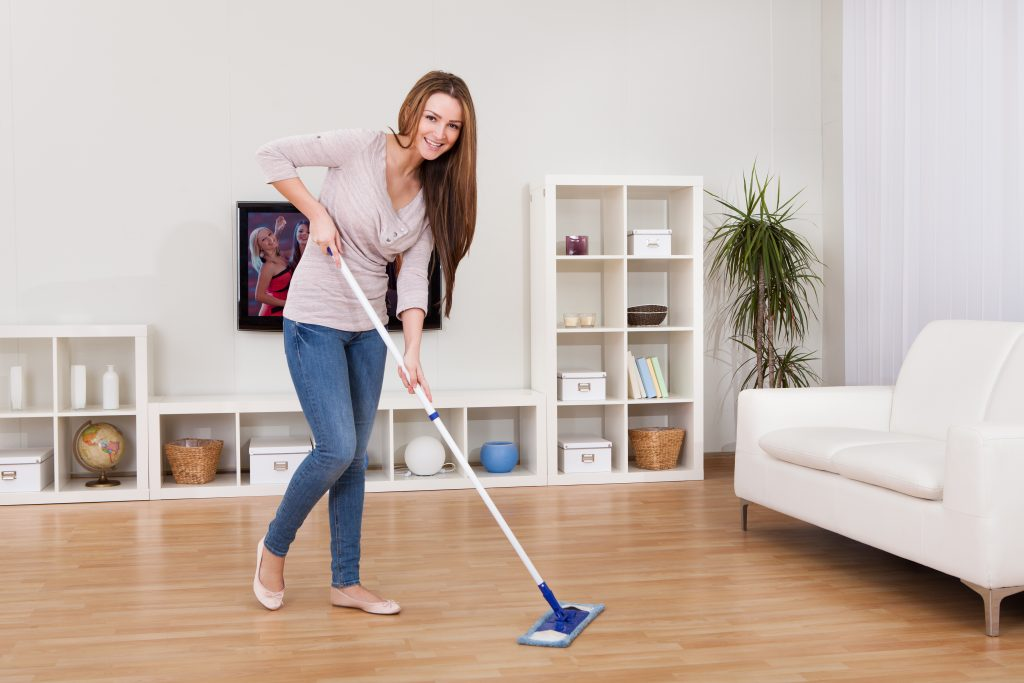 Woman doing her own clean to save money