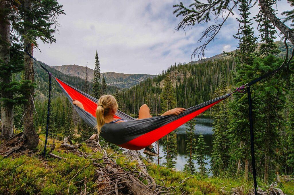 Women enjoying a cheaper alternative to eno hammock by a mountain stream.