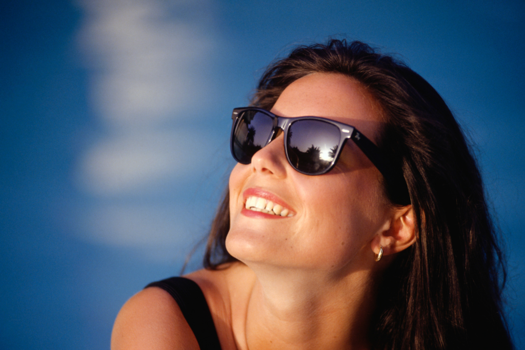 Lady smiling wearing cheaper sunglasses