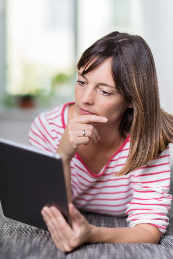 Woman looking at tablet