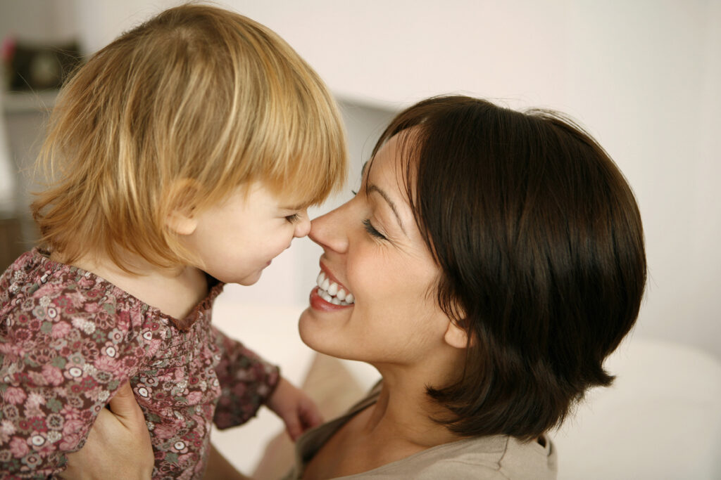 Mother and child smiling at each other