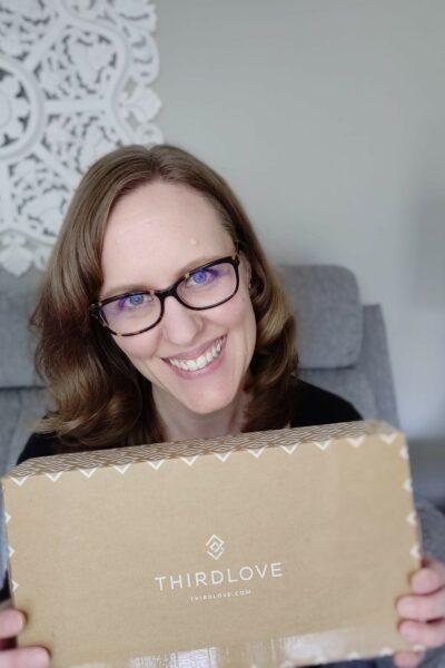 Woman holding ThirdLove bra box