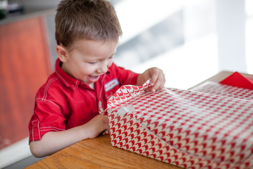 3 year old boy with a gift