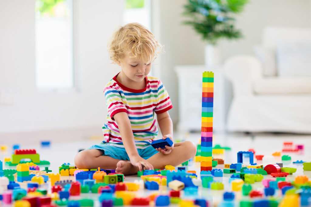 4 year old boy playing with Legos