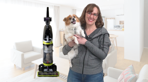Woman with dog and vacuum